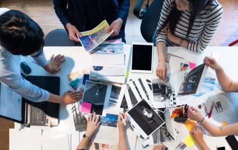 Magazine editors brainstorming in the office. Discussing and looking for new ideas for their magazine.